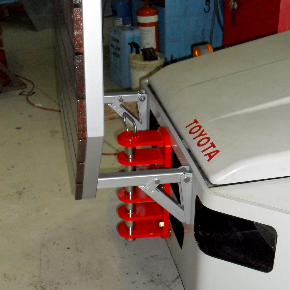 modified aircraft tug with tow hitch and work platform